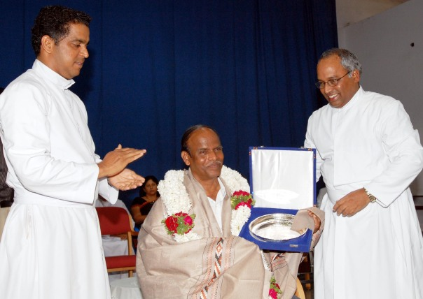 Mr Virupaksha being falicitated