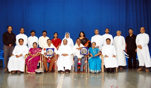 The retiring staff with their spouses posing memories to cherish. On the dais are seen the directors of various institutions of St Aloysius College