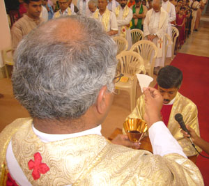 That is Fr Francis Serrao holding the Communion as Fr Henry makes his profession