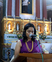 niece of fr leo reading the first reading during the mass