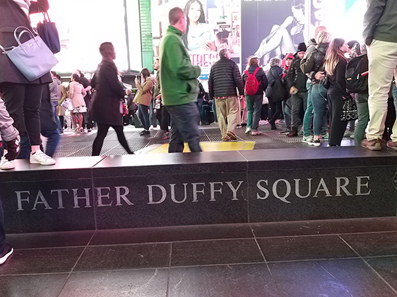 Times Square - Fr Duffy board